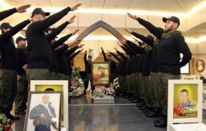 Lebanese Hezbollah militants gesture as